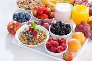 Delicious and healthy breakfast with fruits, berries and cereal