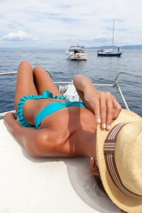 Attractive girl sunbathing on a yacht